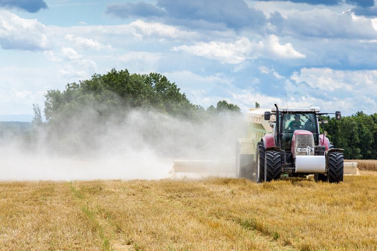 tracktor in a field spreading Chemical Fertilisers
